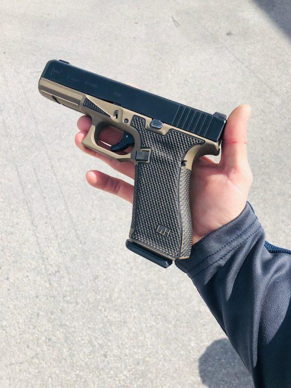 Glock G17 with custom Cerakote, laser engraving, stippling. Best Custom Gun Shop.