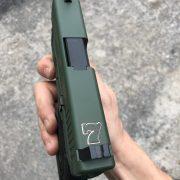 Glock 26 - G26 with cerakote, laser engraving, stippling. best custom gun shop.