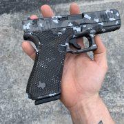Glock 45 - G45 with digicam cerakote, laser engraving, stippling. best custom gun shop.