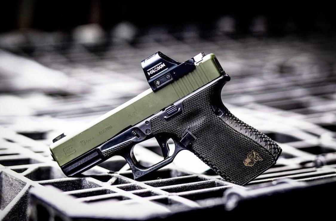 Glock 19- G19 with custom Cerakote, laser engraving, stippling. Best Custom Gun Shop.