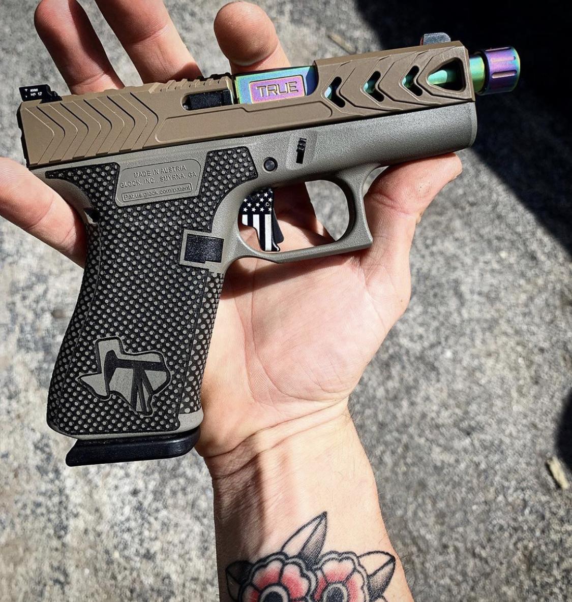 Glock 19 - G19 with custom Cerakote, laser engraving, stippling. Best Custom Gun Shop.