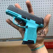 Sig sauer p365 Glock with custom Cerakote, laser engraving.
