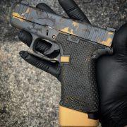 Black and Gold Glock G43x with custom Cerakote, laser engraving, stippling. Best Custom Gun Shop.