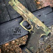 Glock 35 - G35 Glock with custom Cerakote, laser engraving, and stippling. Best custom gun shop.