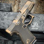 Glock 19 - G19 with distressed burnt bronze cerakote, laser engraving, stippling, undercut, and frame mods. best custom gun shop